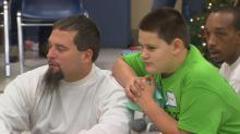 IMAGES: Incarcerated fathers spend time with children for holidays