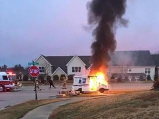 A United States Postal Service worker was unhurt Tuesday when fire ripped through a delivery truck as it made its way through a Wake Forest neighborhood, town officials said. (Photo courtesy Rob Harper)