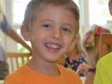 A neighbor said the boy, identified as Everett Copeland, and three other children were playing with new Christmas toys in her yard on Dogwood Bloom Lane when the truck came crashing through.
