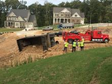 On Oct. 6, workers in the subdivision accidentally caused a dump truck to overturn, one neighbor said.