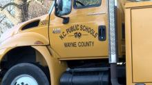 No students were hurt when a school bus and a car crashed into each other in Wayne County, but three people were taken to the hospital, officials said.