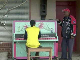Ernest Humphrey is among the amateur musicians to tickle the ivories at the corner of Center and Walnut streets in Goldsboro.