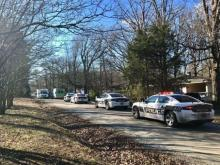 Police officers swarmed Laymans Chapel Road in Durham on Wednesday morning after three men were injured in a shootout.
