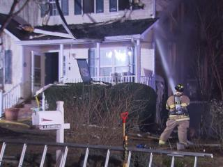 Fire burned through a Raleigh home early Friday morning, leaving most of one side of the dwelling charred.