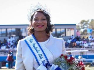 A crowd of about 100 students gathered at Fayetteville State University Monday demanding that the school reinstate Bria Perkins' title of Miss FSU.