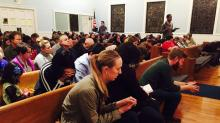 IMAGES: Durham church and advocacy group hold vigil for refugees