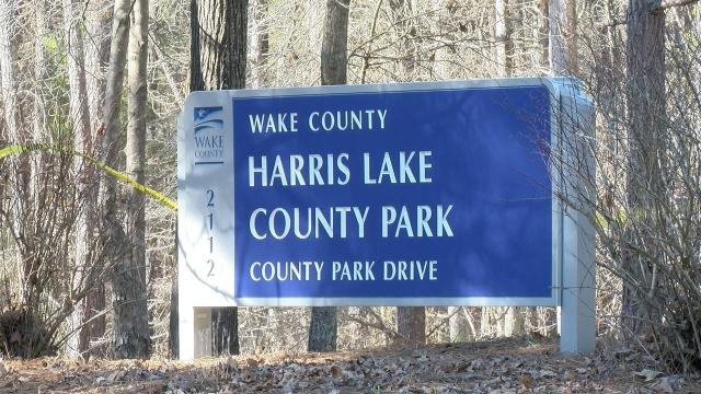 A group of people playing disc golf Sunday afternoon stumbled on a burning body at Wake County's Harris Lake County Park.