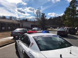 Durham police respond to the scene of an officer-involved shooting in the 2500 block of Glenbrook Drive on Feb. 15, 2017. (Photo by Sarah Krueger)