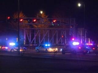 One person died early Sunday when a train stuck a disabled car that was stalled on railroad tracks.