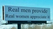 IMAGE: Alternative signs protest 'real men provide, real women appreciate it' billboard