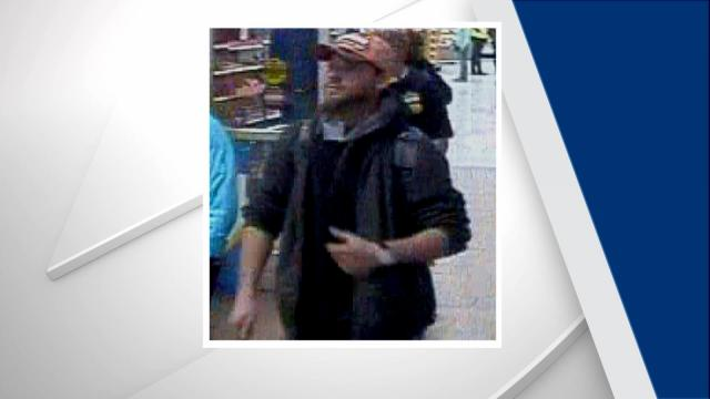 Fayetteville police are searching for a man who threatened employees at two stores with hypodermic needles during thefts.