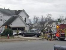 The prognosis was bleak for a woman who crashed her car into two Raleigh houses in January, but her husband shared some good news Sunday afternoon.