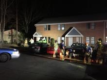 A Raleigh apartment building was damaged after a car crashed into the structure Monday night.
