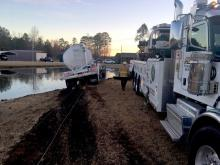 A tractor-trailer plunged into a small pond in Wade early Saturday morning.