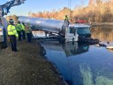 IMAGES: Tractor-trailer plunges into pond near Wade