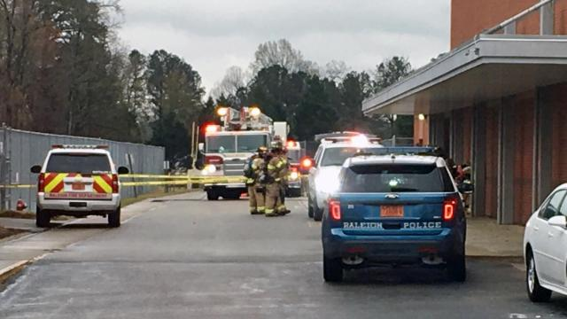 A staff member at Southeast Raleigh High School was treated for smoke inhalation Tuesday morning after a fire destroyed a dryer.