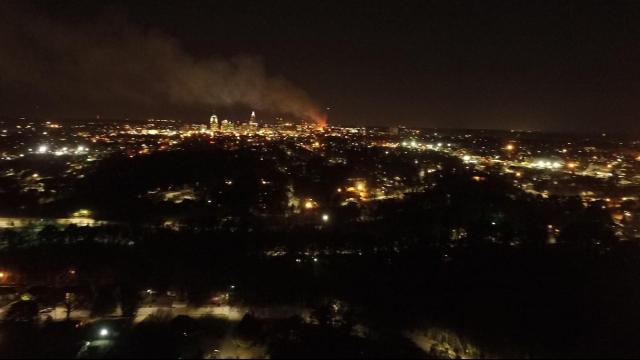 A drone's eye view shows the glow and smoke of a fire in downtown Raleigh. (Courtesty: Adam Larrabee)