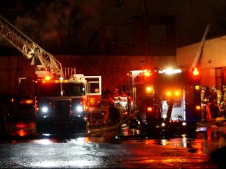 Firefighters battled a five-alarm fire at an apartment building in downtown Raleigh.