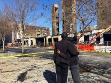 Ten buildings were damaged and roads closed in a busy area of Raleigh between Glenwood Avenue and Capital Boulevard after a 5-alarm fire.
