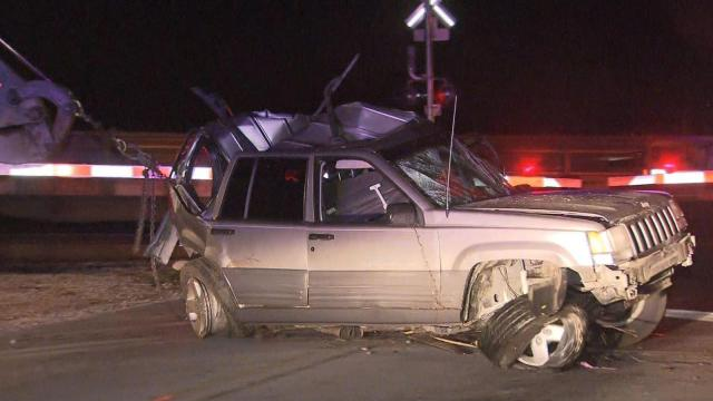 A train crashed into a vehicle that was stopped on the tracks early Tuesday morning near Dunn.