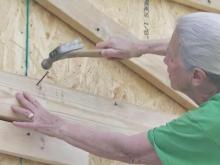 Women's roofing group helps cap Triangle-area Habitat homes
