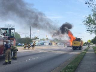 The driver of a heavy equipment truck was taken to the hospital Thursday morning after being burned by a fire that started in the back of the truck.