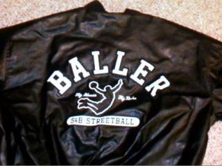 "During the incident, the suspect wore dark colored jeans and a dark cap. He also wore a black jacket with the word ""baller"" written across the back. Photo from the Fayetteville Police Department."