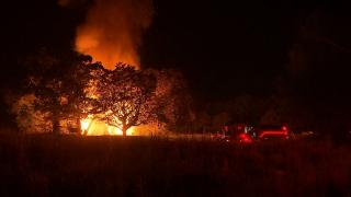 Firefighters from four departments battled a massive fire at a building in Johnston County that lit up the night sky early Tuesday.