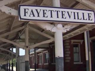 A Trump administration budget outline that would cut $2.4 billion in transportation funds could derail train service in 220 cities across the country, including Fayetteville.