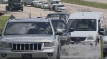 Drivers take the risk, drive through puddles