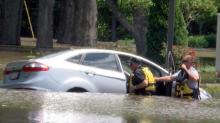 IMAGES: As Neuse rises, crews help rescue Smithfield man stuck in high water