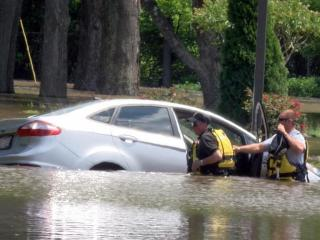 Emergency officials helped a man escape high waters Wednesday afternoon after he drove his car around barricades blocking a section of Hospital Road in Smithfield.