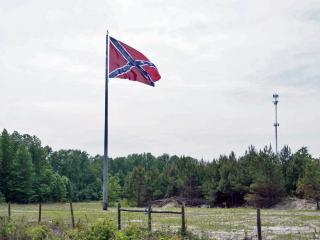 "As part of its ""Flags Across the Carolinas"" project, the North Carolina Division of the Sons of Confederate Veterans has unveiled a massive confederate flag along Interstate 95 in Cumberland County."
