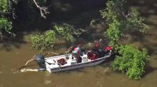 IMAGES: Mother, child clung to tree before rescue from Cape Fear River
