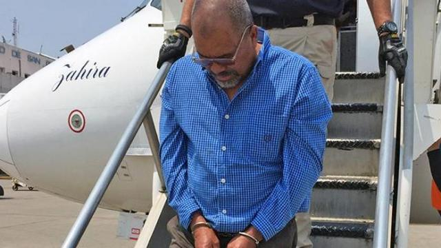 U.S. immigration agents on Monday deported a Honduran man arrested in Hope Mills in February in connection with two homicides that occurred more than 20 years ago.