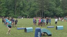 IMAGE: Swift Creek students run, tackle like a Panther in 'Play 60' activities