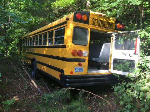 School bus crashes into Cary woods after driver has medical emergency; no kids injured