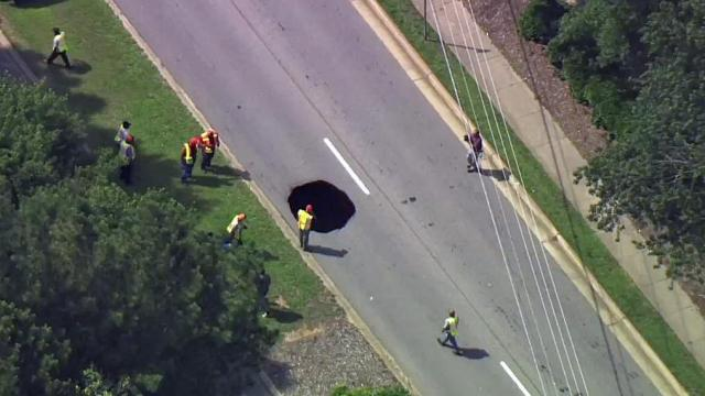 A sinkhole shut down the westbound lanes of Millbrook Road, near Lead Mine Road, in Raleigh on Wednesday.