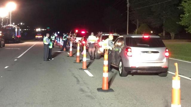 Seven people were arrested and nearly 100 charges were issued following a DWI checkpoint along U.S. Highway 70 in Clayton over the weekend.