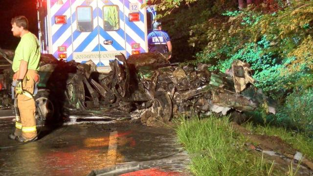 Two people died early Wednesday morning in a fiery, single-car crash near Smithfield.