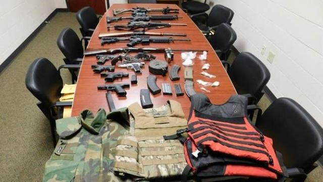 Deputies seized more than a dozen guns, ammunition and drugs from an Orange County home on Thursday after complaints of drug sales at the residence.