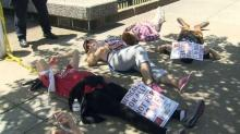 IMAGE: Protesters oppose health care revision, stage sit-in outside Tillis' Raleigh office