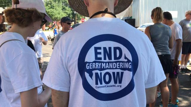 Dozens of people ran through Raleigh on Saturday for a fun run in an effort to end partisan gerrymandering in North Carolina. Photo by James DeAlto