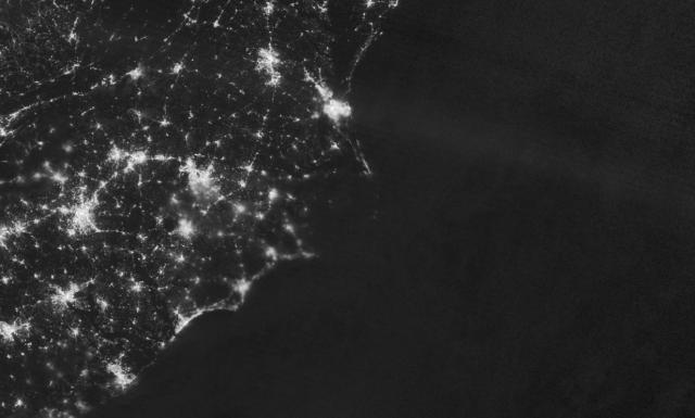 The power outage at Ocracoke and Hatteras islands could be seen from space in images taken by NASA. Here, in an image taken on July 30, the lights are off after the power was knocked out. Photo by NASA