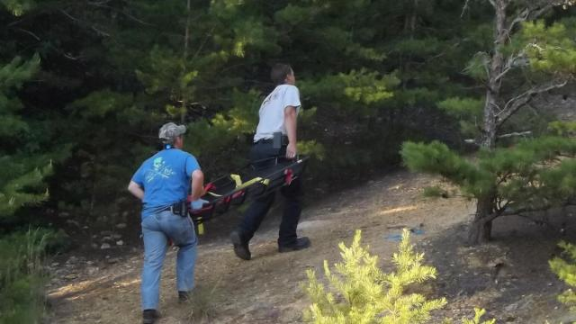 A 16-year-old suffered a broken leg Saturday after falling about 30 feet into rock quarry in Moore County.