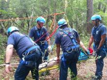 Crews rescue woman trapped on Fayetteville zip line