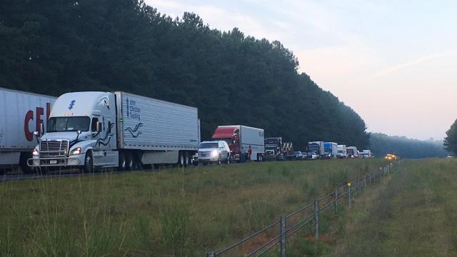 Tractor trailer overturns on US-64, dumping linens on the highway