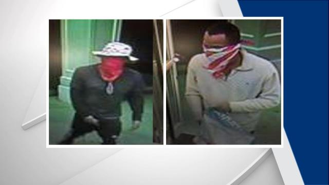 Smithfield police are searching for two men who robbed a CVS Pharmacy at gunpoint early Thursday morning.