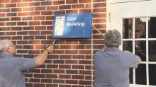 Workers remove name of man tied to racist speech from Durham school
