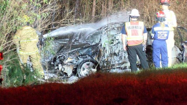 A driver died early Thursday morning near Wilson in a fiery single-car crash, officials said.